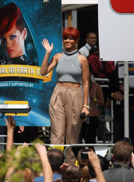 Smile for the fans: Singer Rihanna waves to the crowd outside the Optus Headquarters in Sydney last week
