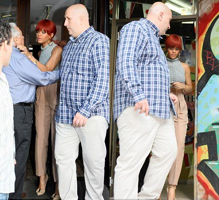 Rhianna and her body guard leaving The Tool Shed sex shop