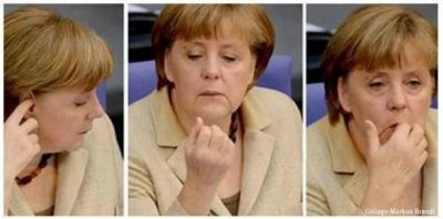 Click για να την δείτε σε μεγάλο μέγεθος  ==============  Merkel peaking ear ..and eating her ear wax!